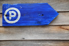 Parking guidepost with letter P, grungy wooden arrow sign. Royalty Free Stock Image