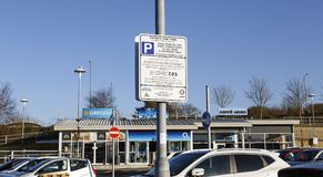 Parking information sign stating the terms and conditions of overstaying Royalty Free Stock Photography