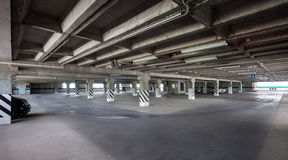 Parking interior / underground garage. Big parking area in basement of building Royalty Free Stock Photos