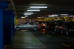 Parking lot. Motion-blurred car in an underground parking lot Royalty Free Stock Photos