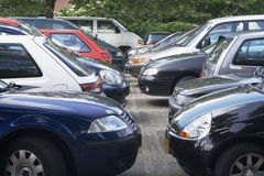 Parking lot. Two rows of parked cars in parking lot stock photography