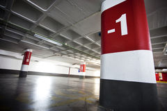 Parking Lot. Underground empty parking lot with red column Stock Photos