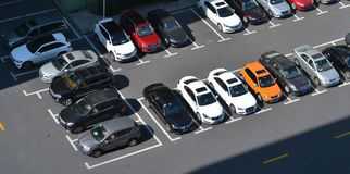 Parking lot. Big parking lot with many cars royalty free stock images