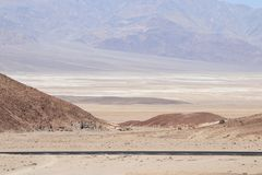 Parking Lot with car at Artist`s Drive in Death Valley National. Park,California, United States with mountain and sand view Royalty Free Stock Photography