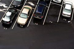 Parked Cars in Parking Lot - Winter Parking. Looking down at cars parked in a parking lot during the winter - empty car space between parked cars stock photos