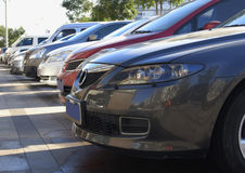 Parking lot cars. Row of cars on parking Stock Photos