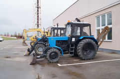 Parking lot construction equipment. Tractors Royalty Free Stock Photo