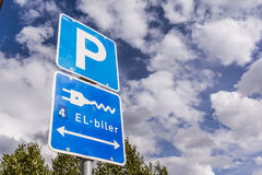 Parking lot for electric cars, sign against blue sky. Parking lot for electric cars in Denmark, sign against blue sky Royalty Free Stock Photography