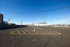 Parking lot. Empty parking lot in industrial area Royalty Free Stock Image