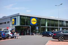 Parking lot in front of the Lidl supermarket of the second generation stock photos