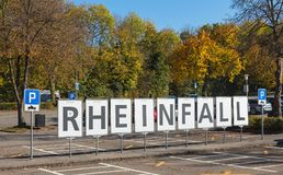 Parking lot at the Laufen castle in Switzerland in autumn. Laufen, Switzerland - 18 October, 2017: the parking lot at the Laufen castle with the sign bearing the Royalty Free Stock Image