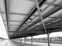 Parking lot. Modern parking lot with a metal structure and solar panels for clean energy, Italy Royalty Free Stock Photos