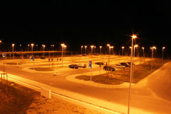 Parking lot at night. An almost empty parking lot at night. Picture taken in Germany stock photos