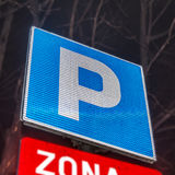 Parking lot with number of authoriszd parking sign. Close Royalty Free Stock Images