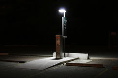 Parking lot pay station at nig Royalty Free Stock Photos
