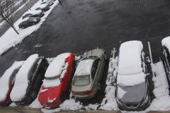 Parking lot in Philadelfia with cars full of snow. During the winter there was a storm that let several cars with snow above them Royalty Free Stock Images