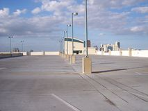 Parking Lot Roof Top Empty1. Empty roof top parking lot with security lighting and distant cameras royalty free stock photography