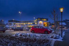 Parking lot and shopping mall in winter at night. Tutzing, Bavaria, Germany, Europe Stock Photos