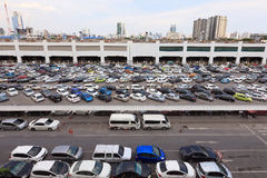 Parking lot and skyline next to Chatuchak Marke. BANGKOK, THAILAND - July 24, 2015: parking lot and skyline next to Chatuchak Market on July 24, 2015 in Bangkok Stock Photo