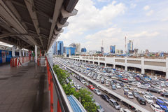 Parking lot and skyline next to Chatuchak Marke. BANGKOK, THAILAND - July 24, 2015: parking lot and skyline next to Chatuchak Market on July 24, 2015 in Bangkok Royalty Free Stock Images
