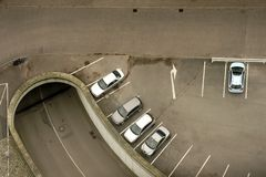 Parking lot top view. Five vehicles standing in a parking lot with an entrance to an underground garage Royalty Free Stock Photography