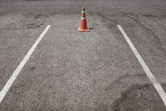 Parking lot with traffic cone on street used warning sign Royalty Free Stock Image