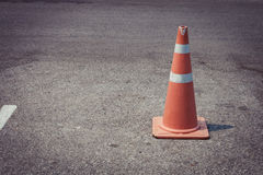 Parking lot with traffic cone on street used warning sign Stock Photo