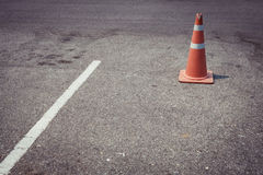 Parking lot with traffic cone on street used warning sign Stock Photography