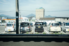 Parking lot with train platform in Japan. NAGASAKI, JAPAN - May 25, 2015 : Parking lot with train platform Royalty Free Stock Photography