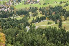 Parking lot and winding road in autum colors. At the Oberjoch Pass Royalty Free Stock Images