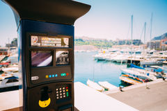 Parking machine with electronic payment at city parking. Royalty Free Stock Image