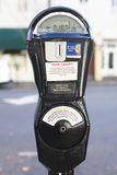 Parking Meter. Closeup of a Black parking Meter With One Hour on The Clock Stock Photos