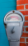 Parking Meter. Up against blue and brick walls Royalty Free Stock Images
