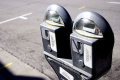Parking meter. Next to an empty parking space on the street royalty free stock image