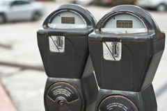 Parking Meter. A pair of parking meters on a quiet street in Miami Beach, Florida royalty free stock photos