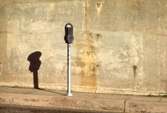A Parking Meter. Sits alone on an empty sidewalk Royalty Free Stock Photos