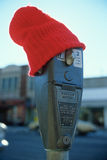 Parking meter wearing a red wool cap, St. Louis, MO Royalty Free Stock Photos