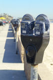 Parking Meters. A row of parking meters by a beach Royalty Free Stock Photos