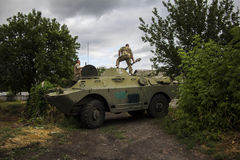 Parking with a military vehicle in Donbass. Soldiers trying to park with a military scout vehicle (BRMD) under the camouflage at a military position in Donbass royalty free stock photography