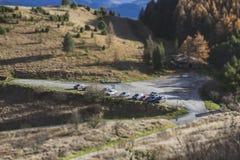 Parking on nature, tilt shift effect. Parking with cars on autumn nature, tilt shift effect royalty free stock image