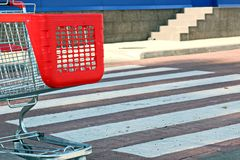 Parking near the supermarket with red shopping trolley royalty free stock photography