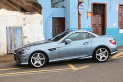 Parking offence. GRAN CANARIA, SPAIN - NOVEMBER 28, 2015: Parking offence in Gran Canaria, Spain. This incorrectly parked Mercedes-Benz SLK stands on yellow royalty free stock photo