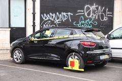 Parking offence in Portugal. LISBON, PORTUGAL - JUNE 6, 2018: Parking offence in Lisbon, Portugal. Clamped wheel for illegal parking. EMEL is Lisbon's municipal royalty free stock photo