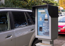 Parking payment terminal on the street the city of Yalta, Crimea royalty free stock photography