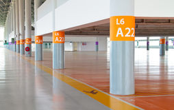 Parking with pedestrian strip and pillar numbering Royalty Free Stock Photos