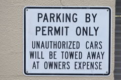 Parking By Permit Only Unauthorized Cars Will Be Towed Away At Owners Expense Sign Stock Photos