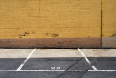 Parking place. Next to a yellow wall royalty free stock image