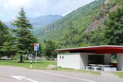 Parking place in the mountains. Resting / bathroom place in the Swiss Alps stock photo