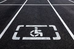 Parking places with handicapped symbol and marking lines Royalty Free Stock Photography