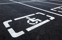 Parking places with wheelchair symbol and marking lines Royalty Free Stock Image